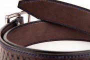 détail d'une pointe de ceinture doublée